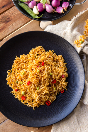 fried: top view portrait of spicy indonesian fried noodle ready to eat Stock Photo