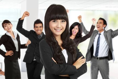 asian adult: A portrait of a young asian businesswoman leading to success