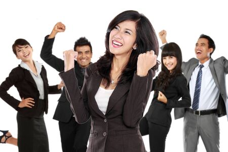 team from behind: A portrait of a young asian businesswoman with her team behind, make a success gesture. isolated in white background Stock Photo