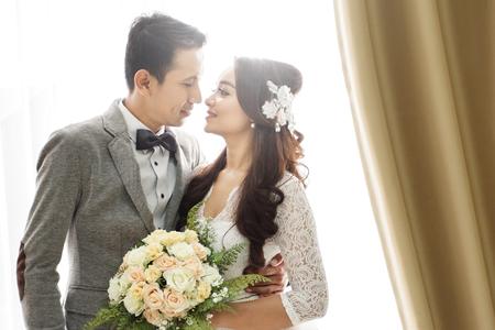 close up portrait of romantic asian newlywed couple