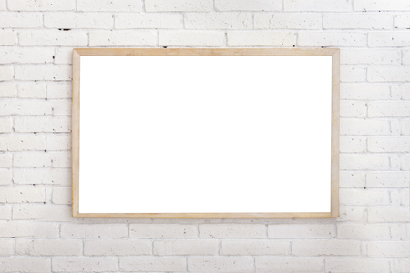 portrait of blank white board with wood frame on ehite brick wall Stockfoto