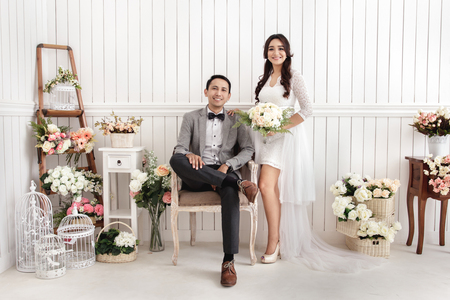 pre wedding photos of romantic newlywed couple at decorated room