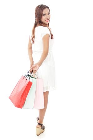 hang body: full body portrait of attractive woman carrying shopping bags while walking isolated on white background Stock Photo