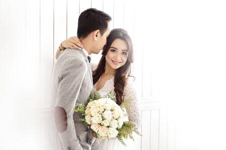 portrait of romantic asian newlywed couple