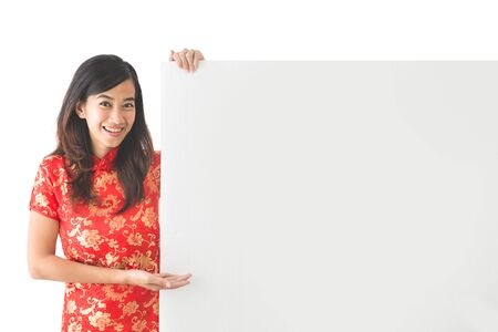 white board: portrait of pretty asian woman wearing traditional chinese dress holding blank white board Stock Photo