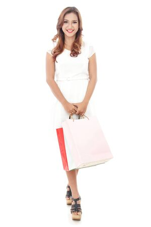 hang body: full body portrait of beautiful woman carrying shopping bags isolated on white background