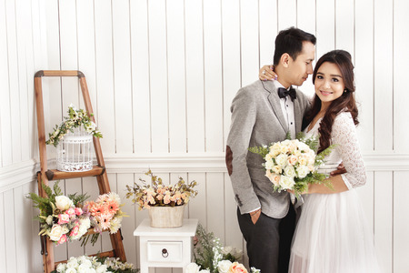 room decor: portait of romantic newlywed couple at decorated room with copy space