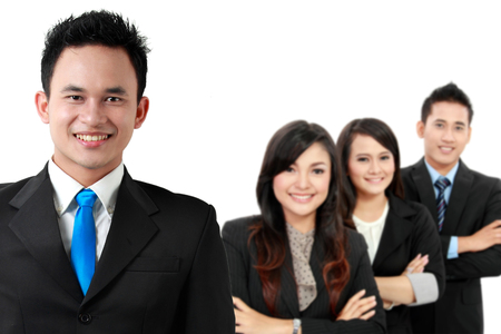 standing together: A portrait of a group of asian young businessperson, isolated in white background