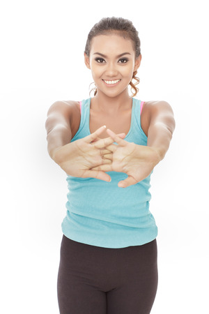 woman stretching: portrait of beautiful young woman doing hands stretching isolated on white background Stock Photo
