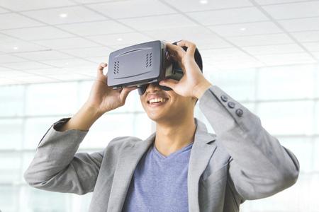 goggle: portrait of asian man wearing virtual reality goggle