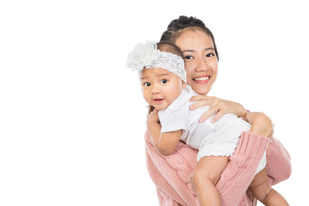 Asian woman holding her baby girl isolated over white background