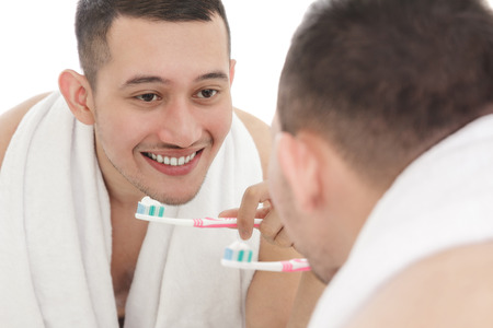 asian man: portrait of handsome man brushing his teeth Stock Photo