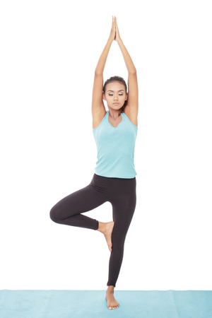 portrait of young woman practicing yoga isolated on white background