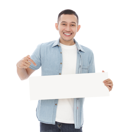 white board: portrait of happy casual man holding and pointing blank white board isolated on white background