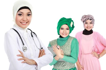 moslem: moslem medical doctor wearing scarf. patient at the background Stock Photo
