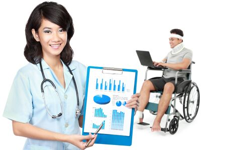 retraining: portrait of medical female doctor and patient using wheel chair at the background Stock Photo