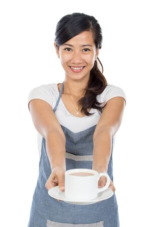 industry background: portrait of young beautiful asian waitress serving coffee. isolated over white background