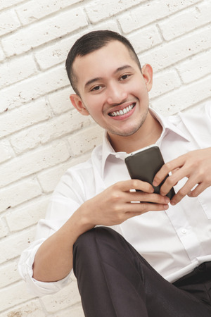 mobilephone: close up portrait of handsome businessman texting on mobilephone Stock Photo