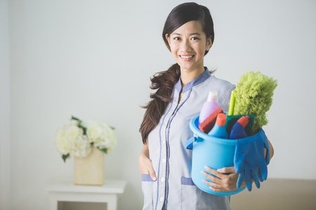 charlady: portrait of young beautiful asian Cleaning maid woman smiling to camera Stock Photo