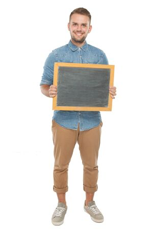 black hands: picture of a young casual man holding a blank blackboard and smiling for the camera. isolated on a white background Stock Photo