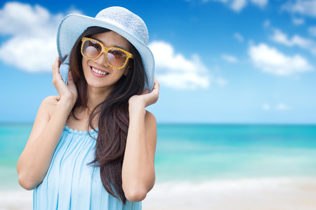 outdoor outside: Happy young woman on the beach, beautiful healthy female face outdoor portrait relaxing outside on the beach Stock Photo
