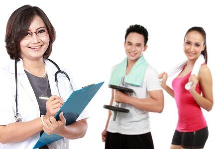 의사와 배경에서 운동을하는 사람들. 흰색에 고립 스톡 콘텐츠