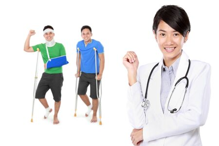 muscle retraining: portrait of Medical Doctor with injured patient  at the background Stock Photo