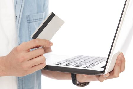 man holding card: close up portrait of a man holding a laptop and credit card isolated on white background