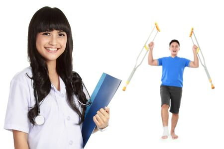 naprapathy: medical doctor with patient at the background using crutch