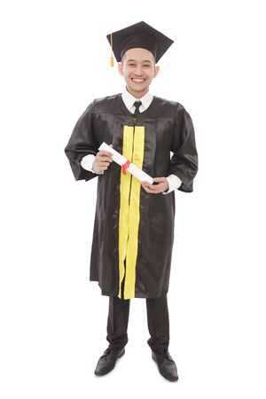 asian boy: full body portrait of young graduation man holding diploma and smiling isolated on white background