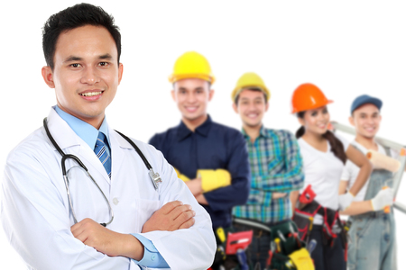 safety at work: portrait of medical doctor and  patient in the background. worker and employee healthcare insurance concept