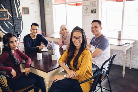 portrait of friends having fun together in a cafe. looking at camera Stock Photo