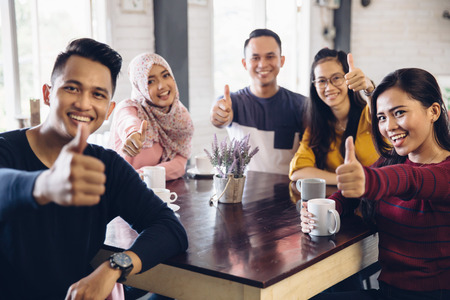 Friends Thumbs up Togetherness Fun Concept Stock Photo