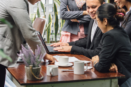 colleagues: portrait of young asian business people meeting in a cafe