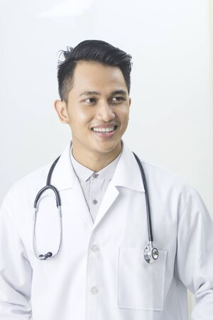 man doctor: portrait of friendly Asian doctor man at his office smiling