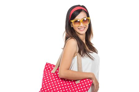 woman bag: young attractive woman in white dress wearing summer hat and sunglasses. isolated over white background