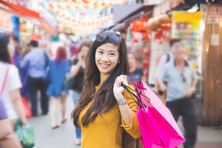 A shot of an asian woman shopping outdoor Stock Photo