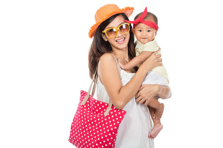 red bandana: portrait of a woman holding her baby girl. ready to go on summer vacation