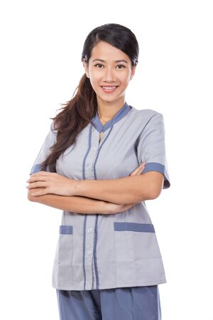 portrait of curious female Asian maid in uniform thinking. isolated over white background