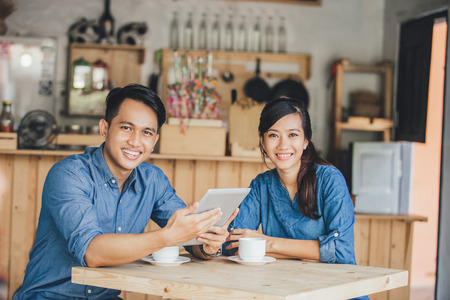 portrait of two young business partner using tablet together in the cafe Stok Fotoğraf