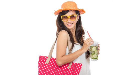white hat: Happy young woman enjoying fresh lime infuse water isolated over white background Stock Photo