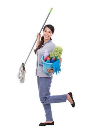 bioclean: portrait of excited Cleaning maid woman smiling to camera and dance. isolated over white background