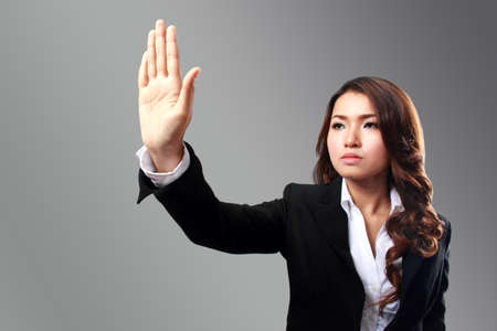 Potrait conceptual businesswoman image of hand pushing something to virtual background