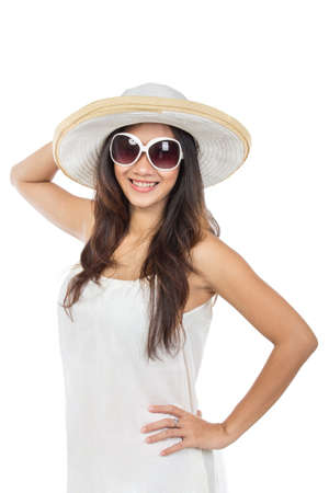 over white: young attractive woman in white dress wearing summer hat and sunglasses. isolated over white background