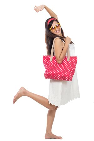 go for: excited woman in white dress raise her arm ready to go for holiday. summer concept Stock Photo