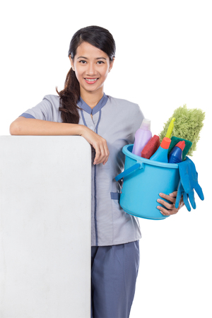 bioclean: portrait of young beautiful asian Cleaning maid woman smiling to camera. isolated over white background