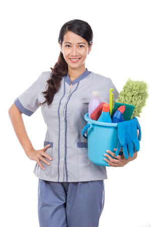 portrait of young beautiful asian Cleaning maid woman smiling to camera. isolated over white background