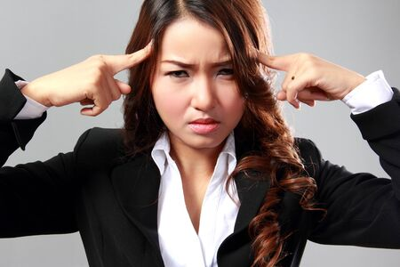 tormented: Young business woman with stressed at work.