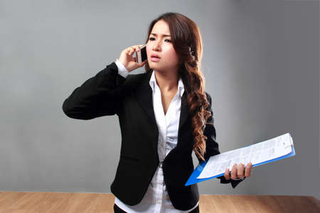 asian lifestyle: portrait of Busy businesswoman calling using mobile phone