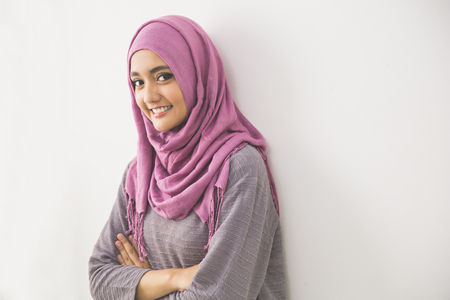 head scarf: Young asian muslim woman in head scarf smile with arms crossed